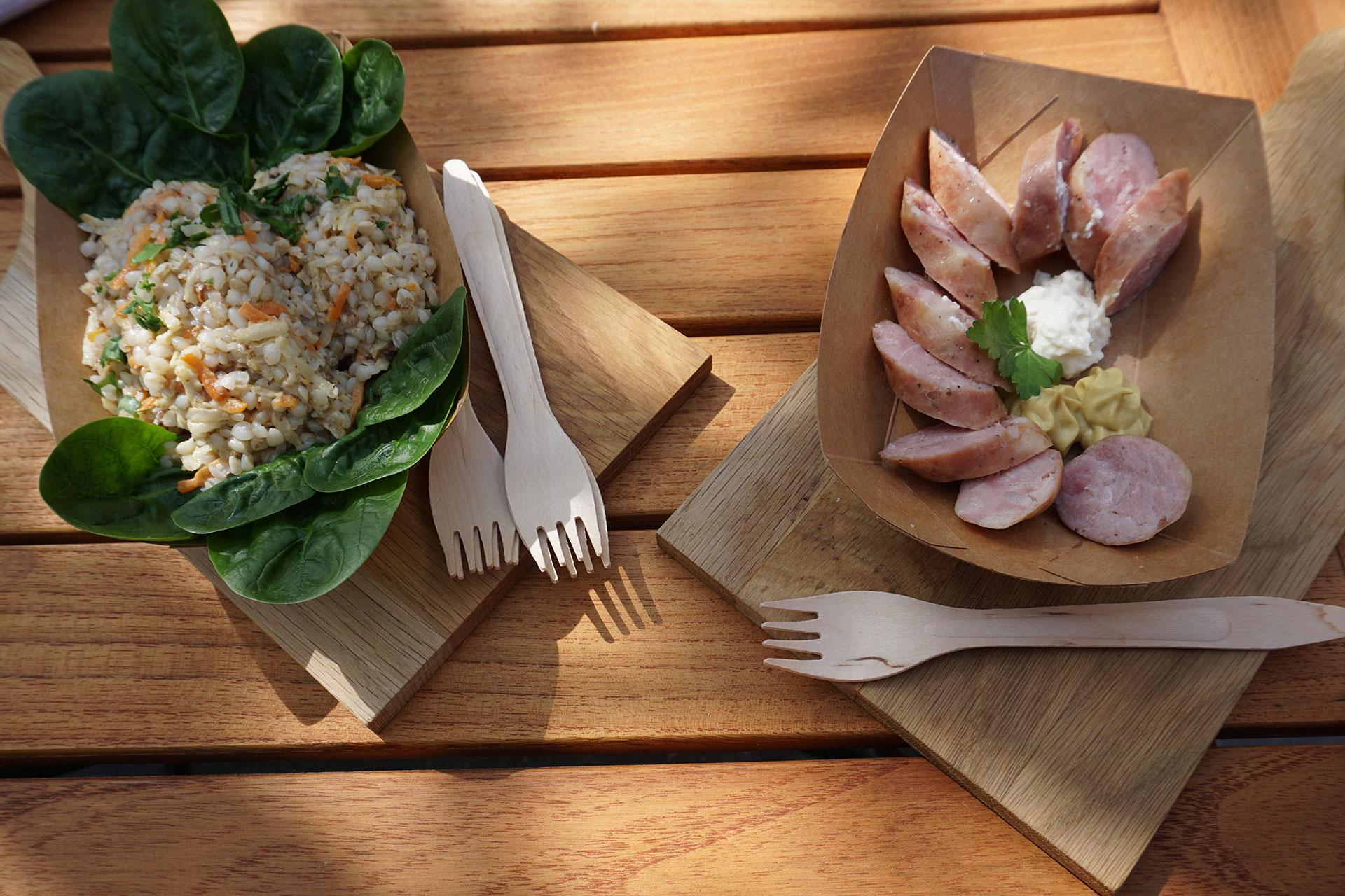 Two delicious plates with food on a wooden table in Ljubljana